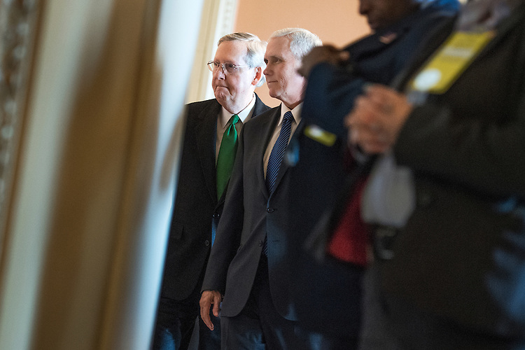 UNITED STATES - MARCH 7: Vice President Mike Pence, right, and Senate Majority Leader Mitch McConnell, R-Ky., arrive for the Republican's Senate Policy luncheon in the Capitol, March 7, 2017. (Photo By Tom Williams/CQ Roll Call)