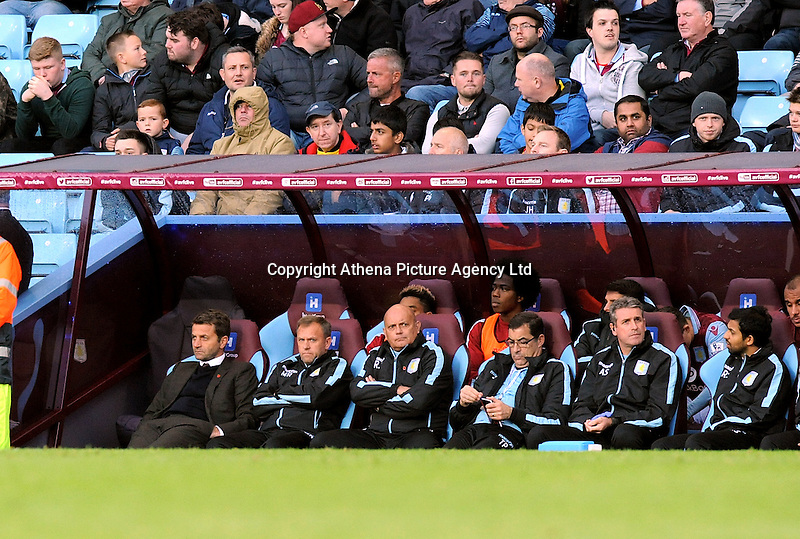 Manager Tim Sherwood of Aston Villa looks dejected slumped in his chair as his side lose at home 1-2 after going ahead during the Barclays Premier League match between Aston Villa v Swansea City played at the Villa Park Stadium, Birmingham on October 24th 2015