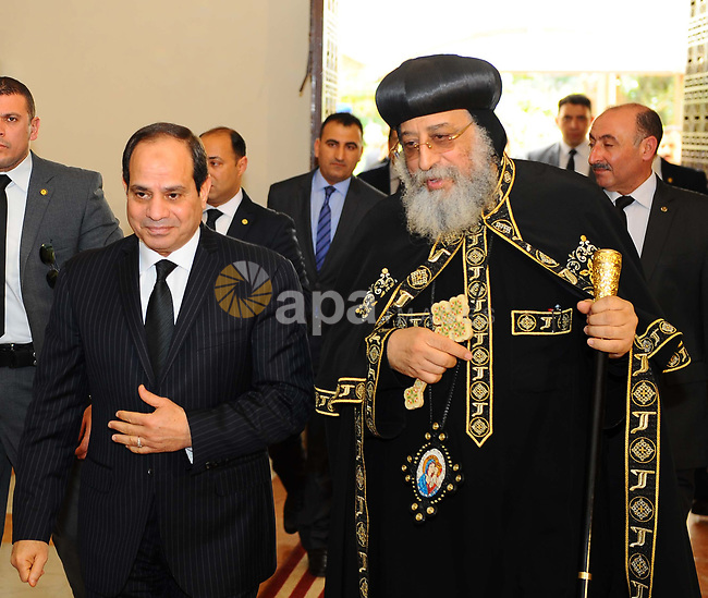A handout picture released by the Egyptian Presidency April 13, 2017 shows Egyptian President Abdel Fattah al-Sisi offering his condolences to Coptic Pope Tawadros II at the headquarters of St. Mark's Coptic Orthodox Cathedral in Abbasiyah in the capital Cairo. Photo by Egyptian President Office