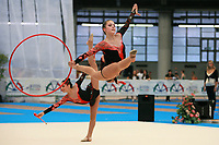 USA Senior Group split leaps with hoops + clubs at 2007 Genoa World Cup of Rhythmic Gymnastics Groups on June 9, 2007 at Genoa, Italy.  (Photo by Tom Theobald)