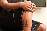 """December 14, 2012. Durham, North Carolina.. The Chinese symbol for """"sacrifice"""". Before the motorcycle accident that ended his basketball career, Jay Williams got several tattoos that would prove ironic during his recovery.. Jay Williams, a former point guard for the Chicago Bulls, is now a college basketball analyst for ESPN. Williams was a freshman all american at Duke University and helped lead the Blue Devils to a NCAA National Championship in 2001. . After being drafted in 2002 to the Chicago Bulls, he played one season in the NBA before his basketball career was ended by a serious motorcycle accident which nearly took his life."""