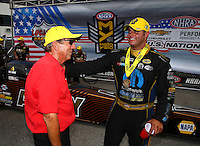 Sep 5, 2016; Clermont, IN, USA; NHRA funny car driver Matt Hagan (right) celebrates with team owner Don Schumacher after winning the US Nationals at Lucas Oil Raceway. Mandatory Credit: Mark J. Rebilas-USA TODAY Sports