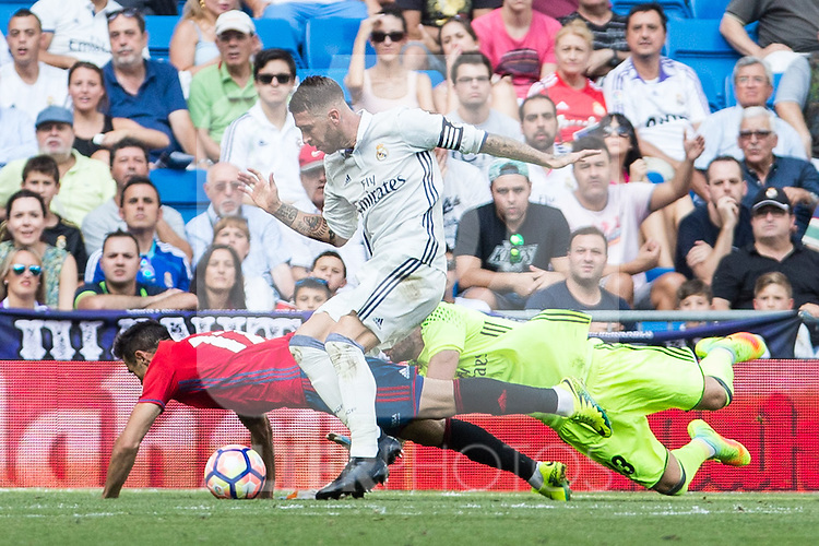 Real Madrid's Sergio Ramos Kiko Casilla and Club Atletico Osasuna's Jaime Romero during the match of La Liga between Real Madrid and Club Atletico Osasuna at Santiago Bernabeu Estadium in Madrid. September 10, 2016. (ALTERPHOTOS/Rodrigo Jimenez)
