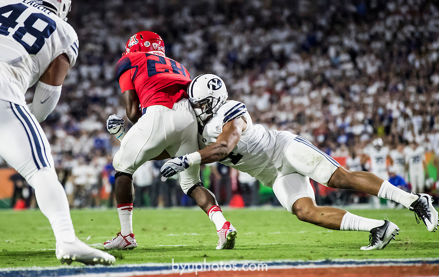 16FTB at Arizona 1408<br /> <br /> 16FTB at Arizona - Cactus Kickoff<br /> <br /> BYU Football defeated Arizona 18-16 in the Cactus Kickoff hosted at the University of Phoenix Stadium in Glendale, Arizona. It was also the first win for new Head Coach Kalani Sitake. <br /> <br /> September 3, 2016<br /> <br /> Photo by Jaren Wilkey/BYU<br /> <br /> &copy; BYU PHOTO 2016<br /> All Rights Reserved<br /> photo@byu.edu  (801)422-7322