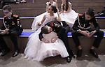 """Katryn, 22 ans durant une séance de yoga avec un portrait du président Poutine dans les locaux du mouvement SET, un mouvement de jeunes designers, artistes, webmasters qui vise à propager l'image du président chez les jeunes et sur les réseaux sociaux ///// """"Kremlin junior ball"""", Moscow. After intense selections, the best dancers of Russian military schools from all over the country gather once a year to celebrate the """"Kremlin Cadet Ball""""."""