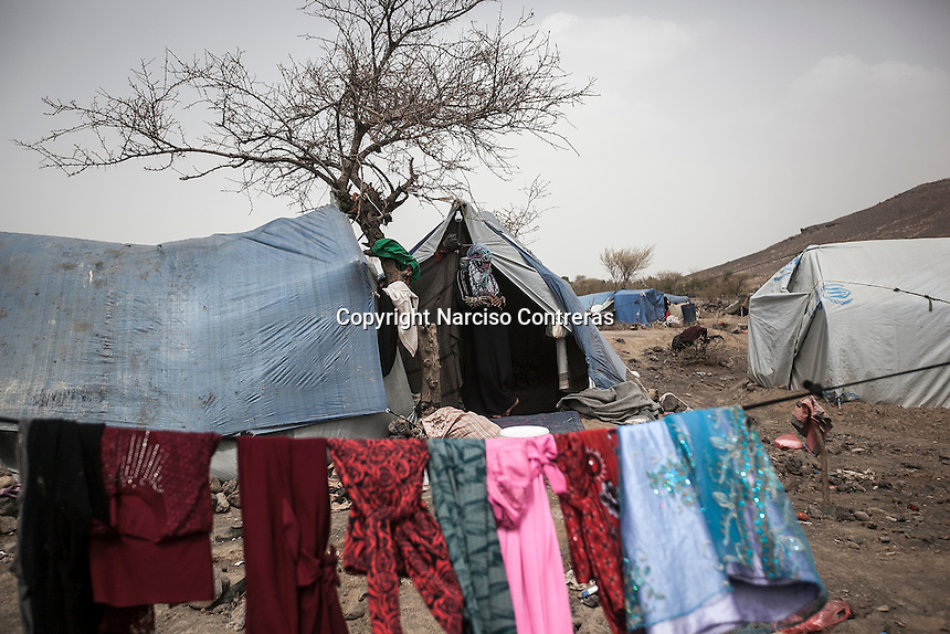 Thursday 09 July, 2015: A displaced woman from the heavy fighting in Haradh bordertown is seen in Darawan, a temporary settlement in the outskirts of Sana'a, the capital city of Yemen. (Photo/Narciso Contreras)