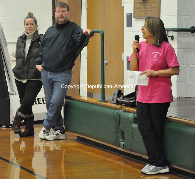 KENT, CT – 10 January 2014 - 011014LMW01 – Mary Ann Van Valkenburg talks to the crowd Friday at the Kent Mother-Daughter Basketball Game, as Donna and Jeff Lloyd look on. Proceeds go to the Jane Lloyd Fund. Lynn Mellis Worthington Republican-American