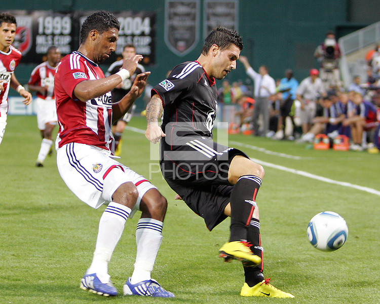 Santino Quaranta #25 of D.C. United  shields the ball from Dario Delgado #12 of Chivas USA during an MLS match at RFK Stadium, on May 29 2010 in Washington DC. United won 3-2.