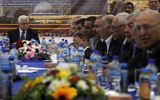 Palestinian President Mahmoud Abbas (C) attends a meeting for the Palestinian Liberation Organisation (PLO) in the West Bank city of Ramallah May 8, 2010. The Palestinian Liberation Organisation (PLO) convened on Saturday and was expected to approve indirect peace talks with Israel, clearing the way for the first negotiations in 18 months. photo by Issam Rimawi
