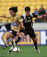 Newcastle's Jin-Hyung Song and Phoenix' Troy Hearfield fight for the ball during the A-League match between Wellington Phoenix and Newcastle Jets at Westpac Stadium, Wellington, New Zealand on Sunday, 4 January 2009. Photo: Dave Lintott / lintottphoto.co.nz