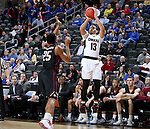 SIOUX FALLS, SD: MARCH 6: Daniel Norl #13 from Omaha spots up for a jumper over Ron Patterson #25 from IUPUI during the Summit League Basketball Championship on March 6, 2017 at the Denny Sanford Premier Center in Sioux Falls, SD. (Photo by Dave Eggen/Inertia)