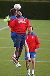 Maurice Edu and Nikica Jelavic heading the ball