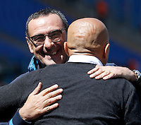 Calcio, Serie A: Roma vs Napoli. Roma, stadio Olimpico, 25 aprile 2016.<br /> Roma&rsquo;s coach Luciano Spalletti, back to camera, greets Napoli&rsquo;s coach Maurizio Sarri prior to the start of the Italian Serie A football match between Roma and Napoli at Rome's Olympic stadium, 25 April 2016. <br /> UPDATE IMAGES PRESS/Isabella Bonotto