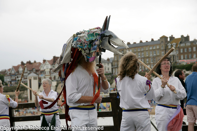 Mummer and morris dancers on the pier at Broadstairs, Kent, UK