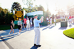 Cuyler McKnight, of High Point, NC, takes a photo of a family just outside of Gate 6 at The Augusta National Golf Club in Augusta, Georgia April 15, 2010. Mr. McKnight has worked at The Masters for 30 years now on the coring committee.