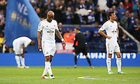 Swansea players look dejected after conceding a third goal during the Barclays Premier League match between Leicester City and Swansea City played at The King Power Stadium, Leicester on April 24th 2016