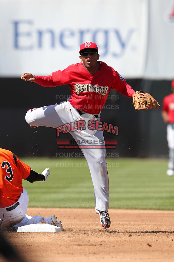 Harrisburg Senators shortstop Josh Johnson #15 attempts to turn a double play during a game against the Bowie BaySox at Prince George's Stadium on April 8, 2012 in Bowie, Maryland.  Harrisburg defeated Bowie 5-2.  (Mike Janes/Four Seam Images)