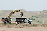 Workers near Williston, North Dakota where there has been a sharp rise in shale drilling for oil in the large Bakken Formation, Thursday, July 18, 2012. ..Photo by MATT NAGER