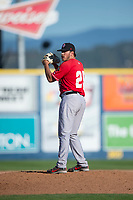 Vancouver Canadians relief pitcher Justin Watts (25) gets ready to deliver a pitch during a Northwest League game against the Spokane Indians at Avista Stadium on September 2, 2018 in Spokane, Washington. The Spokane Indians defeated the Vancouver Canadians by a score of 3-1. (Zachary Lucy/Four Seam Images)