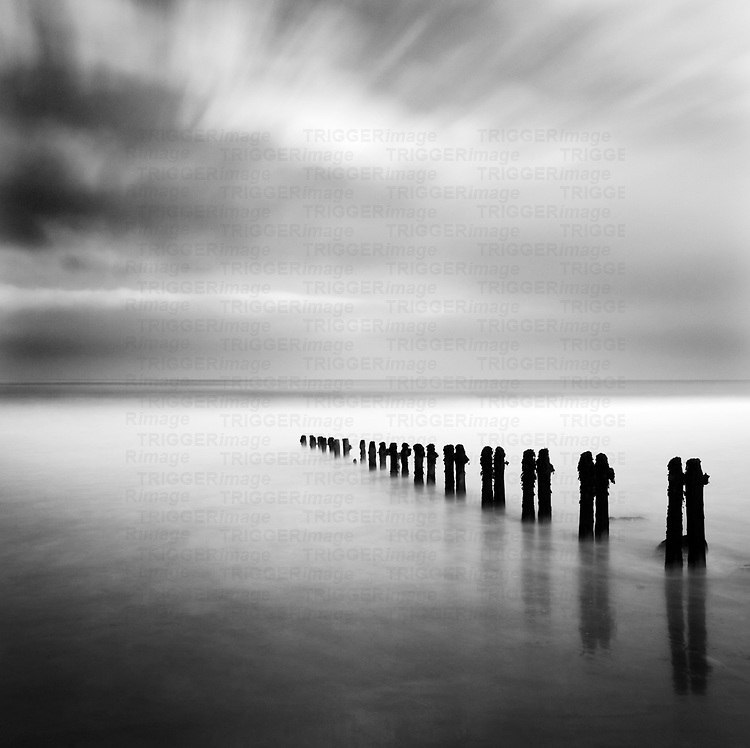 Groynes in the sea with slow exposure