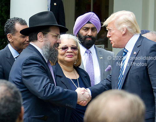 United States President Donald J. Trump shakes hands with Rabbi Levi Shemtov, Executive Vice President of American Friends of Lubavitch (Chabad) board member of the Rabbinical Council of Greater Washington, Vaad Harabonim after signing a Proclamation designating May 4, 2017 as a National Day of Prayer and an Executive Order &quot;Promoting Free Speech and Religious Liberty&quot; in the Rose Garden of the White House in Washington, DC on Thursday, May 4, 2017.<br /> Credit: Ron Sachs / CNP
