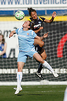 Heather O'Reilly (9) of Sky Blue FC and Stephanie Cox (14) of the Los Angeles Sol battle for a header. The Los Angeles Sol defeated Sky Blue FC 2-0 during a Women's Professional Soccer match at TD Bank Ballpark in Bridgewater, NJ, on April 5, 2009. Photo by Howard C. Smith/isiphotos.com