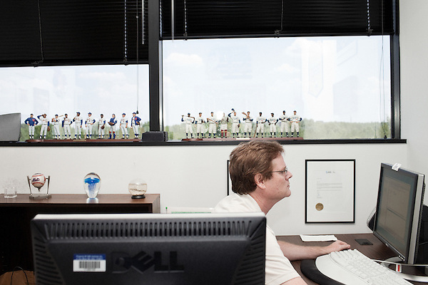 July 29, 2011. Cary, NC.. Baseball fan Christopher Kemper works in his office. Many employees  personalize their offices with decorations and memorabilia.. Profile of SAS, a software company that has many amenities for its employees.