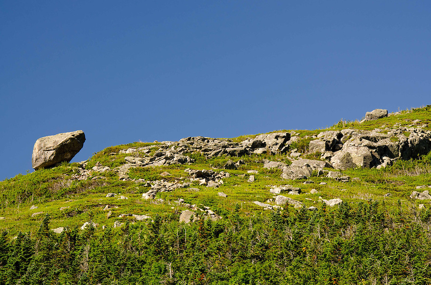Precariously perched at the end of a long ridge, the Glen Boulder has been a landmark in Pinkham Notch since it's discovery.
