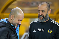 27th December 2019; Molineux Stadium, Wolverhampton, West Midlands, England; English Premier League, Wolverhampton Wanderers versus Manchester City; The Head Coach of Wolverhampton Wanderers Nuno Espirito Santo welcomes Manchester City Manager Pep Guardiola before the kick off  - Strictly Editorial Use Only. No use with unauthorized audio, video, data, fixture lists, club/league logos or 'live' services. Online in-match use limited to 120 images, no video emulation. No use in betting, games or single club/league/player publications