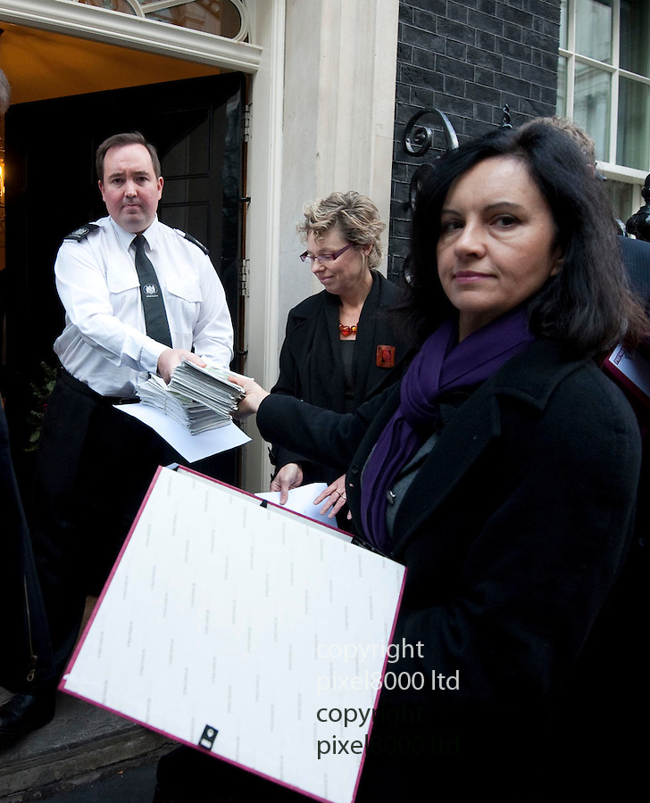 "Pictures show: Campaign for solar energy delivered to 10 Downing Street...Shadow Energy Secretary Caroline Flint delivers the petition.(Shadow Secretary of State for Energy and Climate Change) along with Green Party MP Caroline Lucas and others (see below.)...Campaigners to deliver Downing Street call for Cameron to secure the future of the UK solar industry. .The Cut Don't Kill campaign – a coalition of UK solar power companies, NGOs and consumers – will deliver a letter to Downing Street on Tuesday 13th December calling on David Cameron and Nick Clegg to secure the UK solar industry's future, which is under threat from cuts of over 50% to the Solar Feed-in Tariff. The Tariff cuts were implemented on 12th December at just six weeks' notice, threatening at least 25,000 jobs in a flourishing British renewable industry.. .The letter, which is enclosed in full below and has over 200 signatories, will be delivered to Number 10 Downing Street by Howard Johns, lead spokesman for the Cut Don't Kill campaign and Chairman of the Solar Trade Association; Jeremy Leggett, Chairman of Solarcentury; Gaynor Hartnell, Chief Executive of the Renewable Energy Association; and Andrew Pendleton, Head of Campaigns for Friends of the Earth. As well as a group photocall at Downing Street at 1pm, Howard Johns will be available for broadcast interviews throughout the day.. .Howard Johns, of the Cut Don't Kill campaign, said:. .""This cut to the Feed-in Tariff is devastating for our industry, leaving thousands of workers faced with redundancy at Christmas. We are calling on David Cameron and Nick Clegg to recognise that solar power is a great UK success story, and to destroy the sector now would be totally counterproductive. The Government should assess fully the great contribution solar makes to the UK economy and renewables agenda, and step in to secure the future of this crucial technology."". .To arrange broadcast interviews, request further statements or confirm attendan"