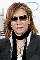 Japanese rock star Yoshiki of X JAPAN poses for cameras during the second day of the New Economy Summit (NEST 2017) on April 7, 2017, Tokyo, Japan. The annual summit brings together global entrepreneurs and innovators for a two-day event in Tokyo. (Photo by Rodrigo Reyes Marin/AFLO)