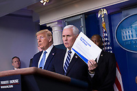 United States President Donald J. Trump, left looks on as US Vice President Mike Pence makes remarks on the Coronavirus crisis in the Brady Press Briefing Room of the White House in Washington, DC on Saturday, March 21, 2020.<br /> Credit: Stefani Reynolds / Pool via CNP/AdMedia