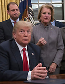 United States President Donald J. Trump listens as US Senator Shelley Moore Capito (Republican of West Virginia) makes remarks prior to his signing the bipartisan Interdict Act, a bill to stop the flow of opioids into the United States in the Oval Office of the White House in Washington, DC on Wednesday, January 10, 2018.  The Interdict Act will provide Customs and Border Protection agents with the latest screening technology devices used to secure our border from illicit materials, specifically fentanyl, a powerful opioid that is destroying lives across the country. <br /> Credit: Ron Sachs / Pool via CNP