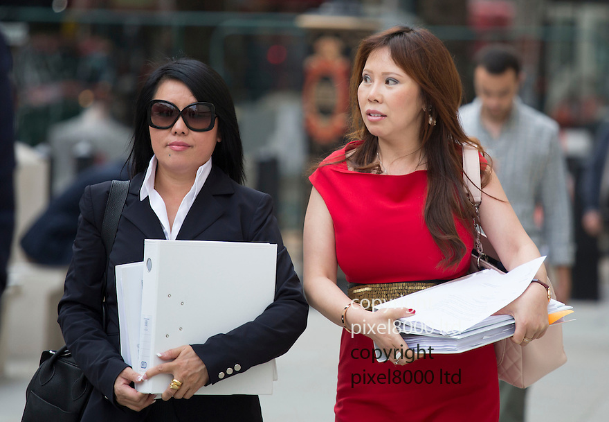 pic shows: Cheng Yin Sun  (black dress)  - also known as &quot;Kelly&quot;  arrives at court with Phil Ivey\<br /> <br /> <br /> <br /> World's number one poker star Phil Ivey arrives at the High Court in London today 2.10.14<br /> He arrived with his legal team carrying bundles of papers in his case against Crockfords casino in Mayfair, London which is owned by Gentings.<br /> <br /> The high stakes gambler who is suing Britain&rsquo;s oldest gaming club for withholding his &pound;7.3million payout<br /> They claim he was &quot;edge counting&quot;<br /> <br /> He arrived with two women of Asian appearance who may be part of his legal team or involved in the case.<br /> <br /> <br /> <br /> <br /> <br /> <br /> Pic by Gavin Rodgers/Pixel 8000 Ltd