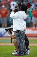Atlantic Coast Conference contract photographer Wade Payne peeks out from along side the stadium camera man during the game between the Florida State Seminoles and the North Carolina Tar Heels in the 2017 ACC Baseball Championship Game at Louisville Slugger Field on May 28, 2017 in Louisville, Kentucky. The Seminoles defeated the Tar Heels 7-3. (Brian Westerholt/Four Seam Images)