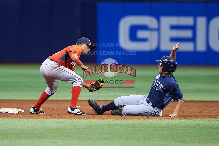 Boston Red Sox Jeremy Rivera (11) tags out Rene Pinto (50) sliding into second during an instructional league game against the Tampa Bay Rays on September 24, 2015 at Tropicana Field in St Petersburg, Florida.  (Mike Janes/Four Seam Images)