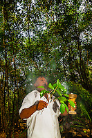 A Mayan shaman performing a purification ceremony in the jungle, near Riviera Maya, Mexico