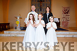 The pupils from Coars NS who made their First Holy Communion on Saturday in the Church of the Immaculate Conception, Foilmore pictured front l-r; Ella O'Neill, Mary Kate O'Sullivan, Isabella Gannon back l-r; Fr. Larry Kelly & Siobhan O'Shea.