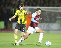 Burnley's Dwight McNeil battles with Burton Albion's Scott Fraser<br /> <br /> Photographer Mick Walker/CameraSport<br /> <br /> The Carabao Cup Round Three   - Burton Albion  v Burnley - Tuesday  25 September 2018 - Pirelli Stadium - Buron On Trent<br /> <br /> World Copyright © 2018 CameraSport. All rights reserved. 43 Linden Ave. Countesthorpe. Leicester. England. LE8 5PG - Tel: +44 (0) 116 277 4147 - admin@camerasport.com - www.camerasport.com