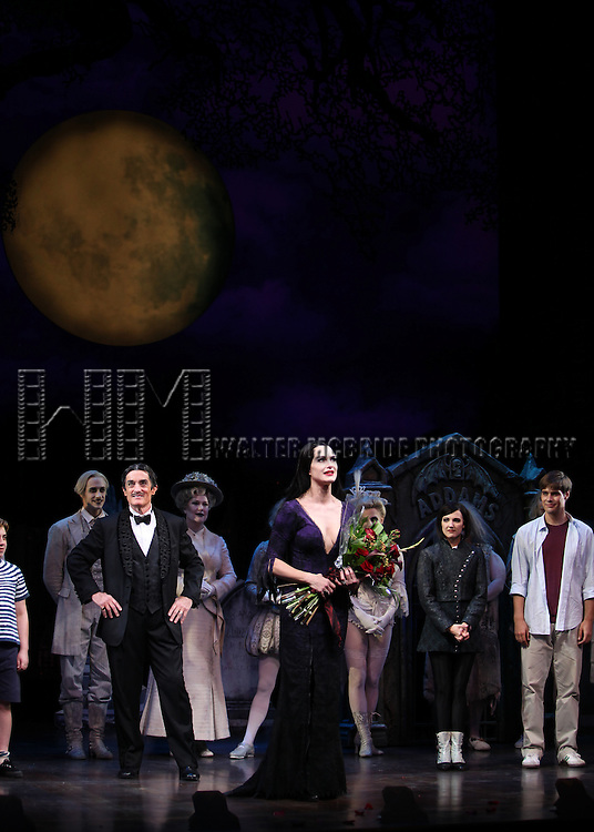 Brooke Shields as Morticia Addams & Roger Rees with ensemble cast.at the Curtain Call for her debut in 'The Addams Family' at the Lunt-Fontanne Theatre  in New York City.