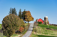 Red barn and silo along a country road, Madison, New York, USA