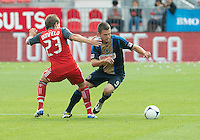 15 September 2012: Toronto FC midfielder Terry Dunfield #23 and Philadelphia Union forward Jack McInerney #9 in action during an MLS game between the Philadelphia Union and Toronto FC at BMO Field in Toronto, Ontario..The game ended in a 1-1 draw..