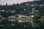Nanaimo city, residential houses on a sea shore in a misty sunset scenery, Vancouver Island, British Columbia, Canada. Image © MaximImages, License at https://www.maximimages.com