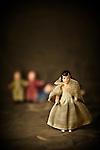Vintage porcelain doll on stage wearing evening gown