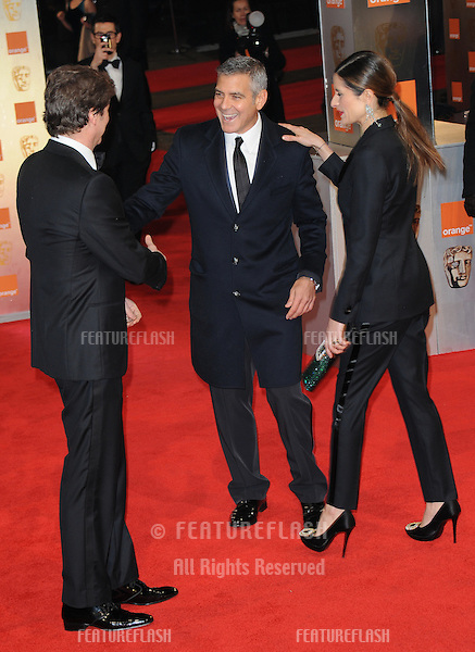 Colin Firth, George Clooney, Livia Giuggioli attends the Orange British Academy Film Awards 2012 at the Royal Opera House..February 12, 2012, London, UK.Picture: Catchlight Media / Featureflash