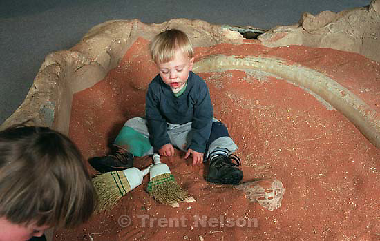 Nathaniel Nelson diggin up bones at the Children's museum. Noah Nelson at left<br />