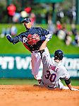 3 March 2010: Atlanta Braves' infielder Yunel Escobar turns a double play during a Grapefruit League game against the New York Mets at Champion Stadium in the ESPN Wide World of Sports Complex in Orlando, Florida. The Braves defeated the Mets 9-5 in the Spring Training matchup. Mandatory Credit: Ed Wolfstein Photo