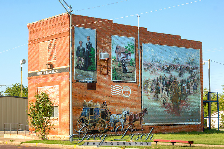 Davenport Oklahoma Murals. The 1891 Land Run scene from Harper's Weekly is the tallest mural on Route 66, soaring 32 feet high on the south side of the 1905 Farmers Bank Bldg.  Other scenes are of Nettie Davenport, first postmaster and namesake of the town, and her log cabin post office.