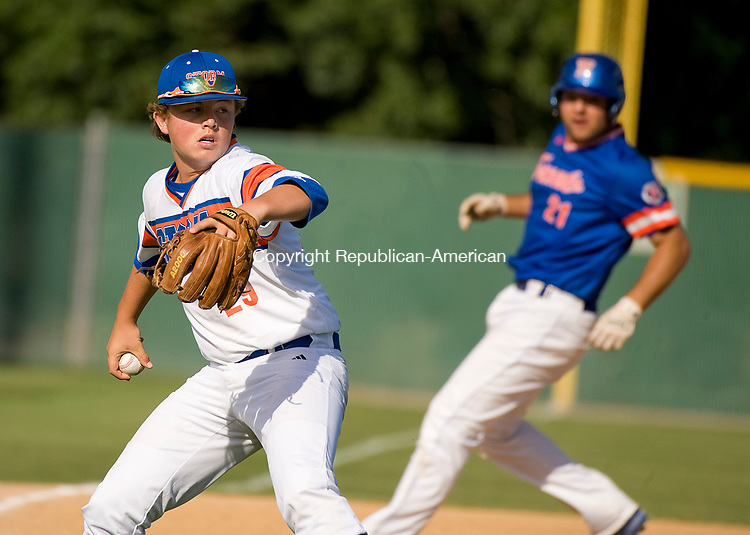 WATERBURY, CT-0712917JS22- Wolcott's Trey Nastri (29) looks to throw to first as Toronto's Tyler Offman (21) makes his way to third base during their Mickey Mantle World Series game Saturday at Municipal Stadium in Waterbury. <br /> Jim Shannon Republican-American