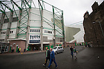 Fans walking past the Famous Five Stand at Easter Road stadium before the Scottish Championship match between Hibernian and visitors Alloa Athletic. The home team won the game by 3-0, watched by a crowd of 7,774. It was the Edinburgh club's second season in the second tier of Scottish football following their relegation from the Premiership in 2013-14.